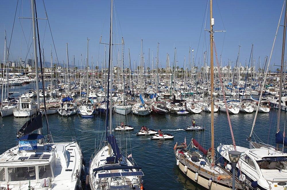 Spain, Catalonia, Barcelona, Yachts moored in Port Olimpic marina.