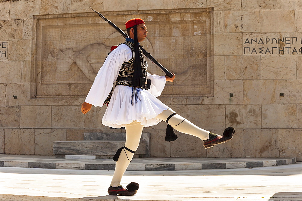Greece, Attica, Athens, Greek soldier, Evzone, marching beside Tomb of the Unknown Soldier, outside Parliament building.