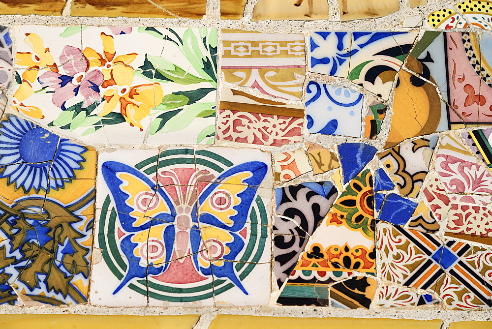 Spain, Catalunya, Barcelona, Parc Guell by Antoni Gaudi, one of the tiled mosaic benches on Banc de Trencadis.