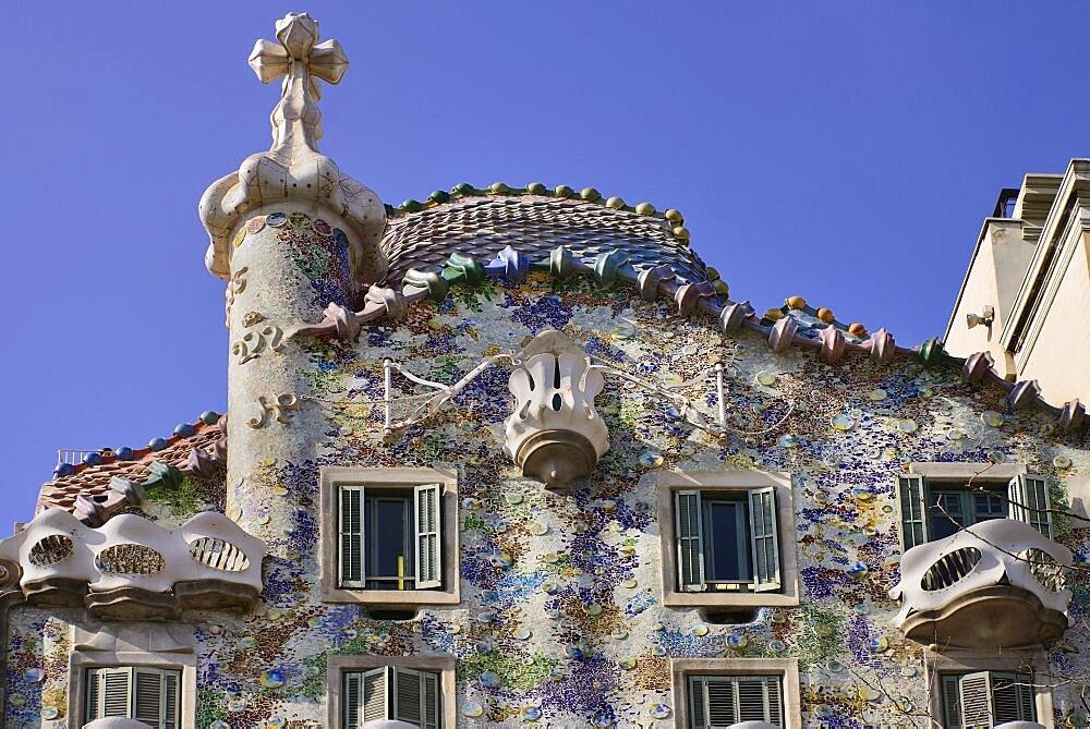 Spain, Catalunya, Barcelona, Casa Batllo by Antoni Gaudi, upper section of the exterior facade.