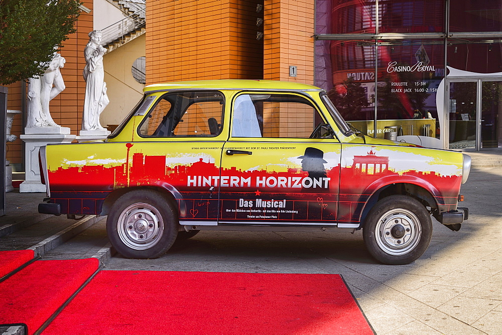Germany, Berlin, Potzdamer Platz, Old Trabant car redecorated and now being used as advertising for a show.