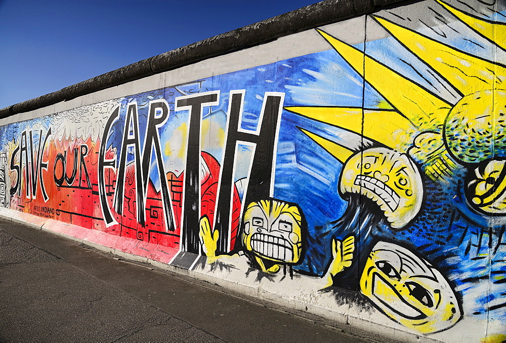Germany, Berlin, The East Side Gallery, a 1.3 km long section of the Berlin Wall, Mural known as 'Save our Earth' by Artist Indiano.