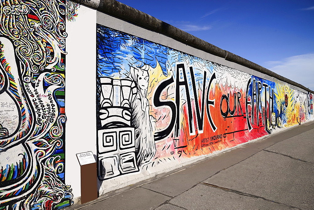 Germany, Berlin, The East Side Gallery, a 1.3 km long section of the Berlin Wall, Mural known as Save our Earth by Artist Indiano.