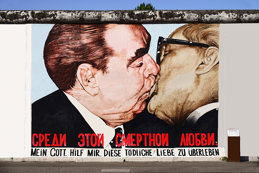 Germany, Berlin, The East Side Gallery, a 1.3 km long section of the Berlin Wall, Mural called 'My God help me survive this deadly love' Soviet Premier Brezhnev kisses East German Chancellor Honecker.