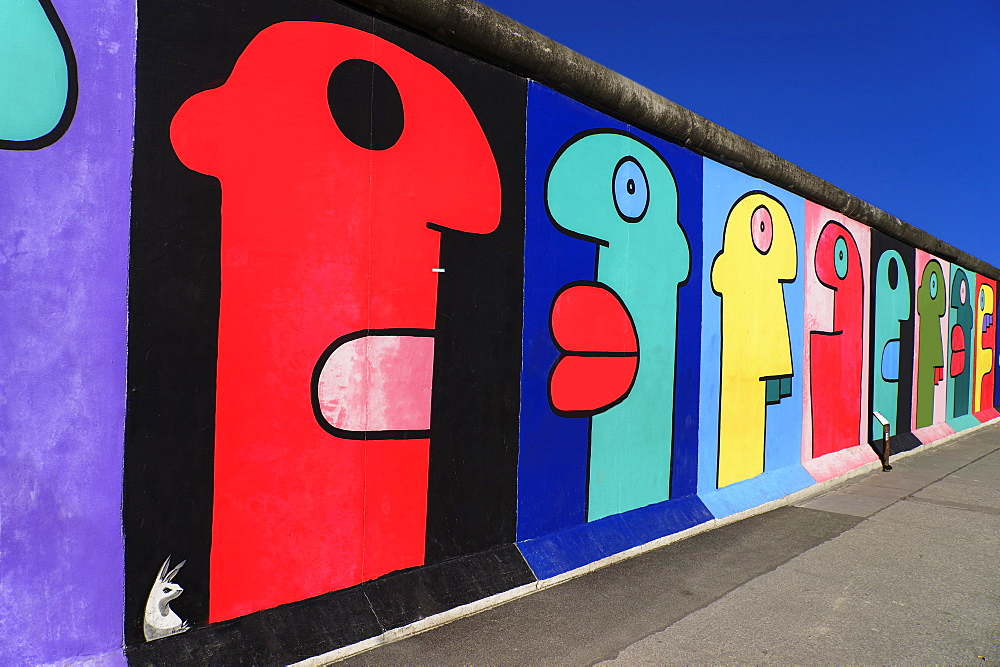 Germany, Berlin, The East Side Gallery, a 1.3 km long section of the Berlin Wall, Mural called Homage to the Young Generation by Thierry Noir.  - 797-12079