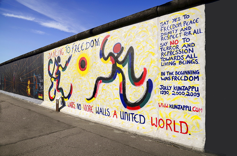 Germany, Berlin, The East Side Gallery, a 1.3 km long section of the Berlin Wall, Mural by Jolly Kunjappu called 'Dancing to Freedom'.