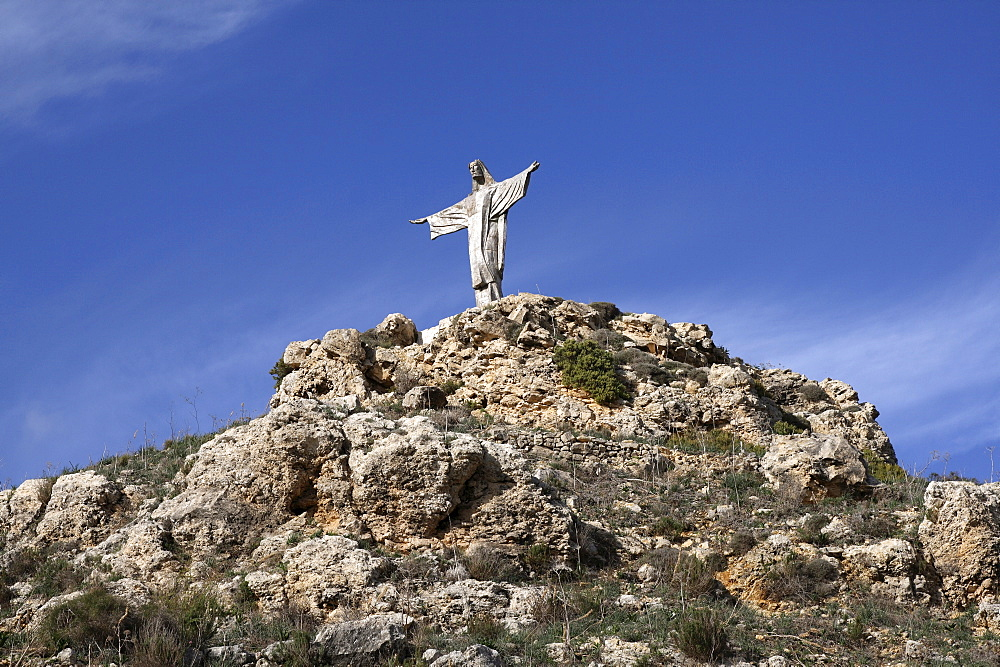 Malta, Gozo, Christ statue on hill near Marsalforn.