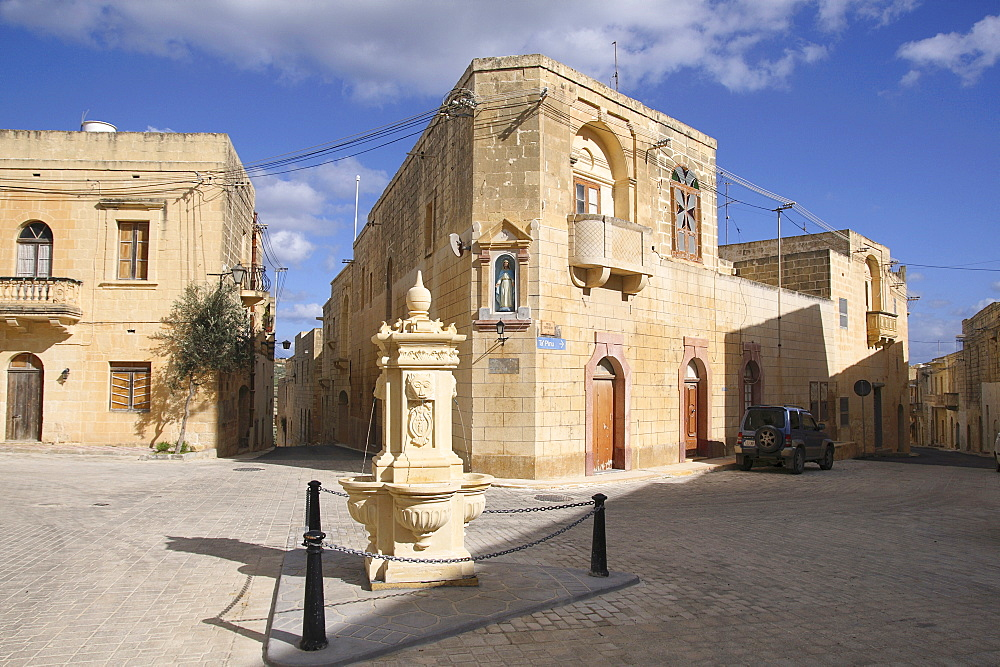 Malta, Gozo, Gharb, old town with stone fountain.