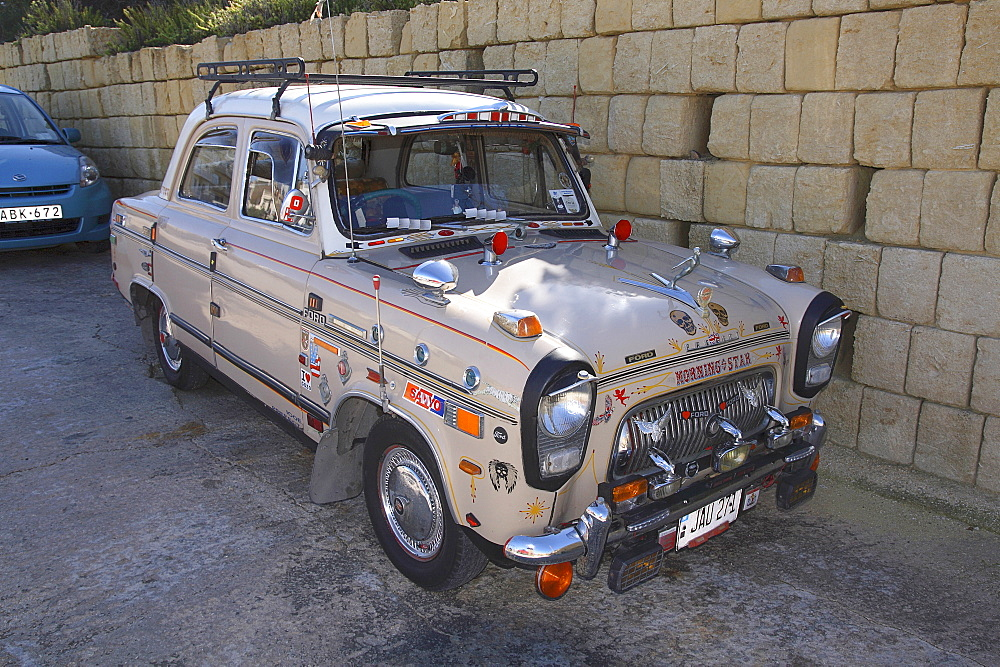 Malta, Gozo, near Marsalforn, customised vintage Ford Prefect car.