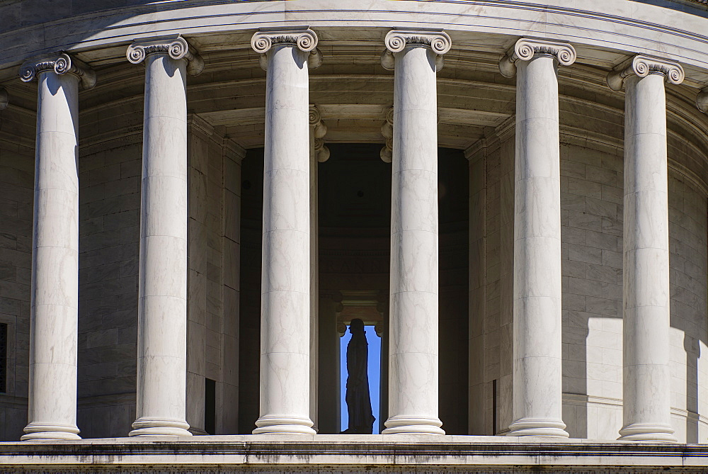 USA, Washington DC, National Mall, Thomas Jefferson Memorial, Close up view from west side with staue of Jefferson visible through the building's Ionic columns.