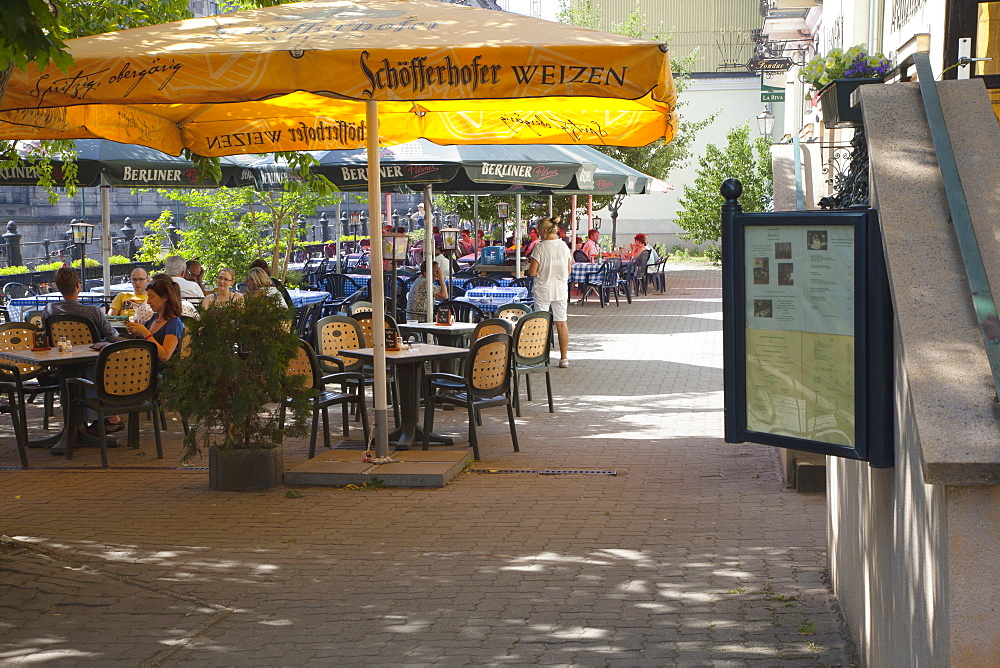 Germany, Berlin, Mitte, Cafes, restaurants and bars under leafy shade on the banks of the river Spree.