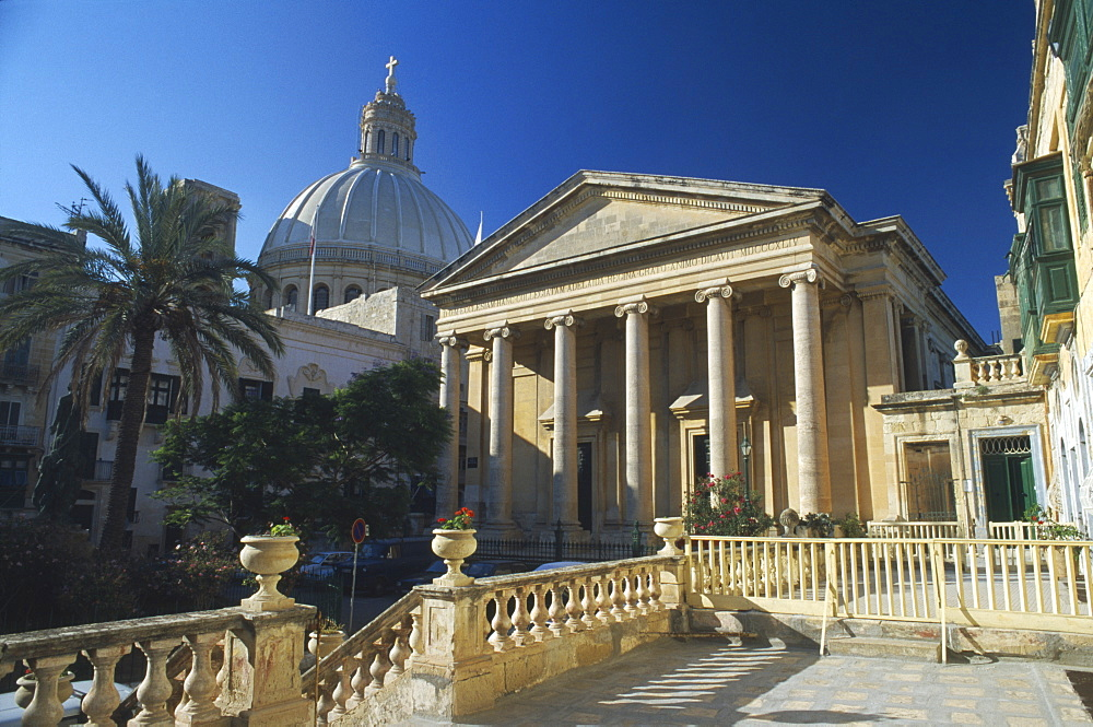 MALTA  Mdina St Pauls Anglican Catherdral with dome of Carmelite Church behind.