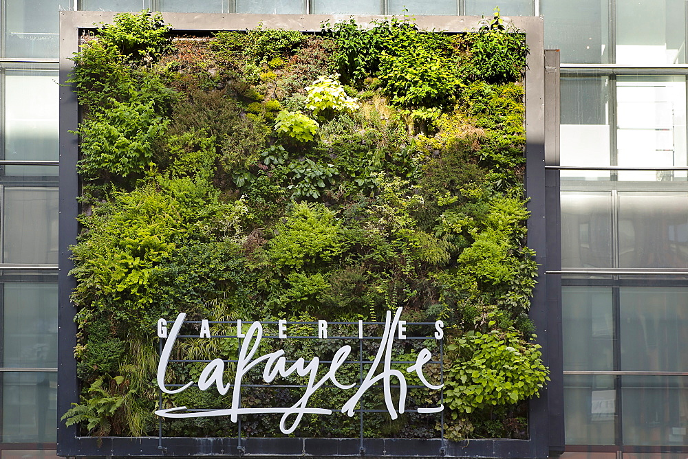 Germany, Berlin, Mitte, Vertical planting on the exterior of Galeries Lafayette on Friedrichstrasse.