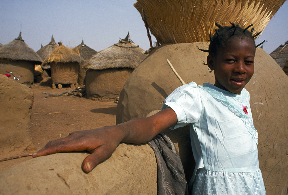 BURKINA FASO Bisaland Sigue Voisin Village Young girl in village near Garango.
