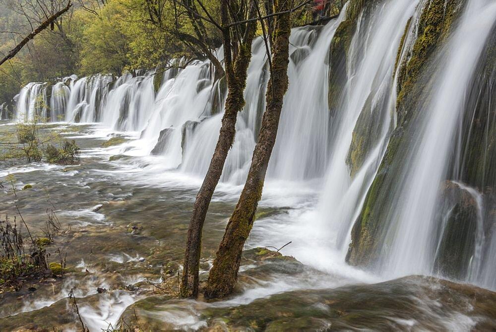 China, Sichuan, Blurred waterfall at Jiuzhaigou Valley National Park.