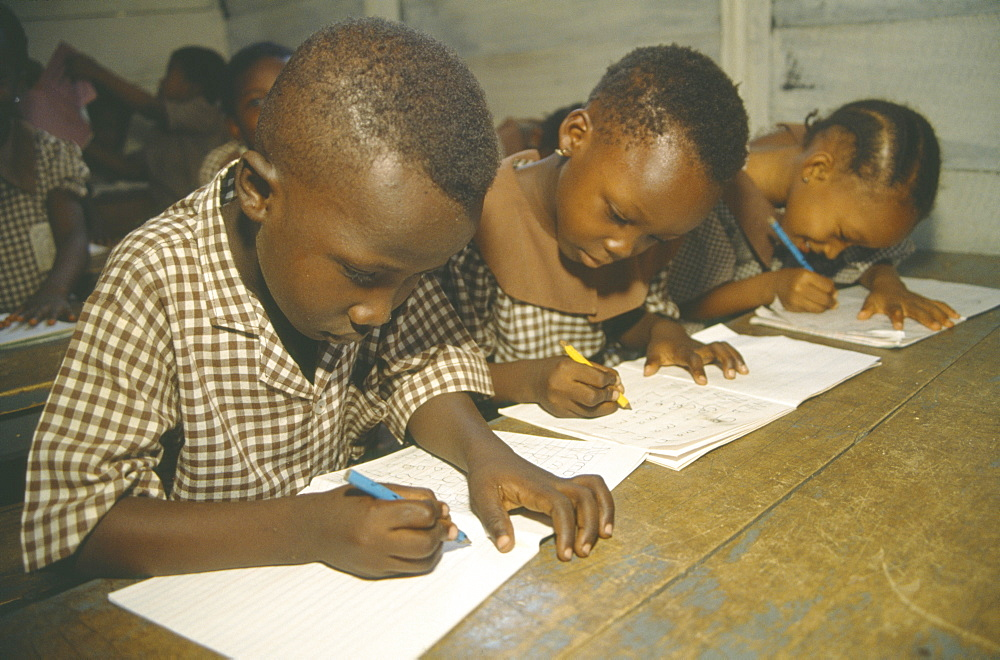 GHANA  Accra Primary school pupils writing at their desks.