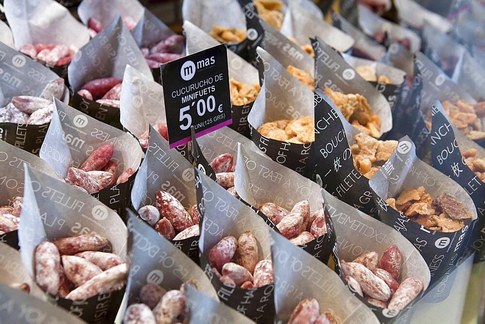 Spain, Madrid, Tapas on sale at Mercado de San Miguel.
