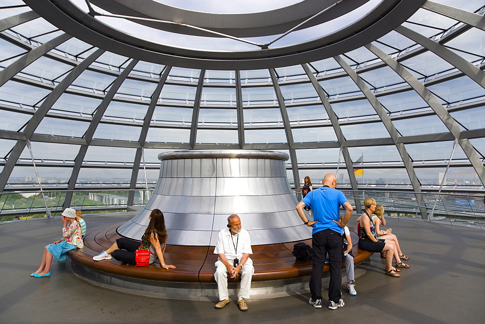 Germany, Berlin, Mitte, Tiergarten, interior of the glass dome on the top of the Reichstag building designed by architect Norman Foster with the hot air vent on top of the mirrored cone that reflect light into the debating chamber of the Bundestag below.