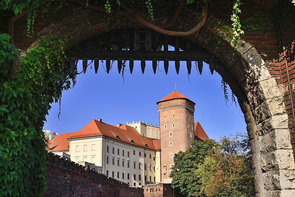 Poland, Krakow, Wawel Hill, Wawel Castle, An artillery tower view through gateway.