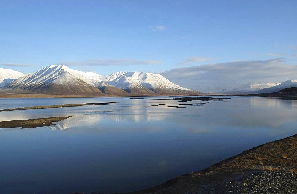 Norway, Svalbard, Longyearbyen, View across Adventfjorden toward snow capped mountain.