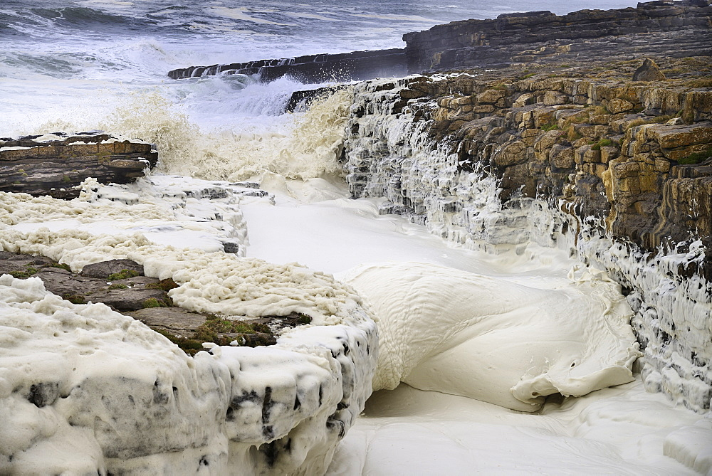 Ireland, County Sligo, Streedagh,  Foam being generated by stormy seas.