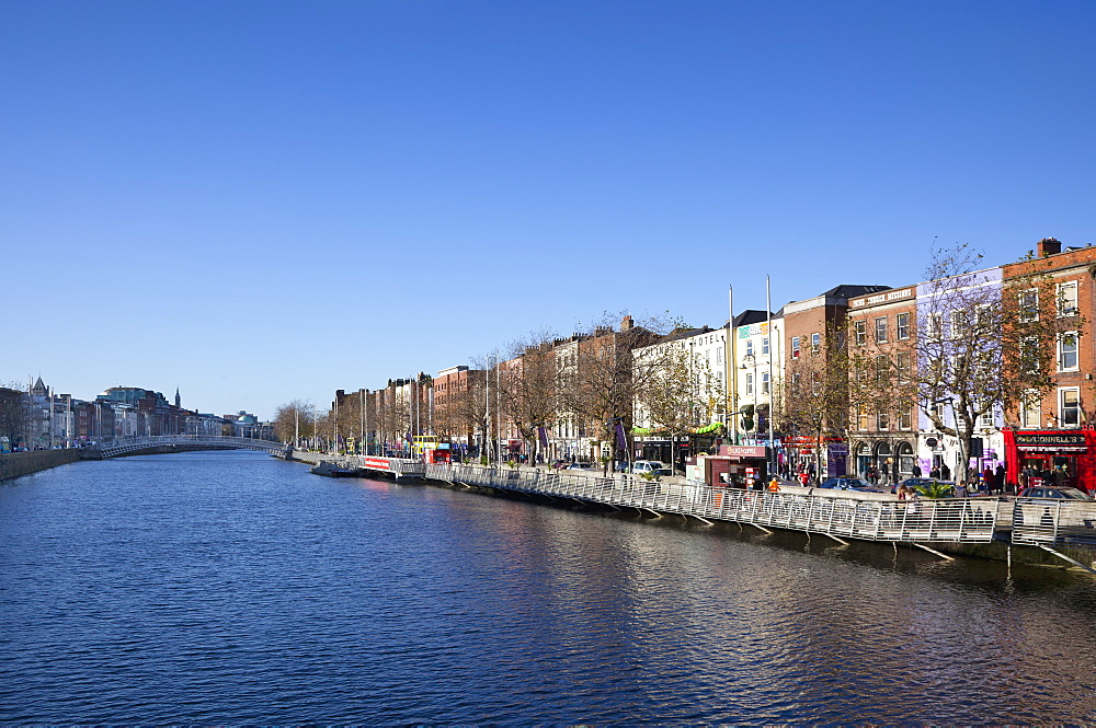 Ireland, Dublin, View along the River Liffey toward the Ha'penny bridge.