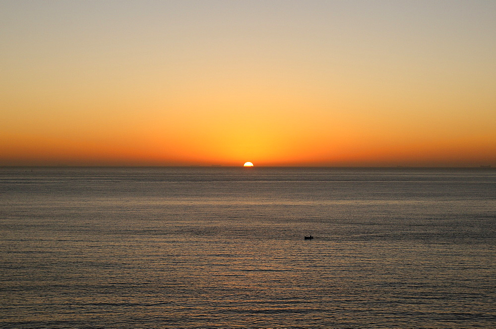 Malta, Sliema, Mediterranean sunrise and small fishing boat.