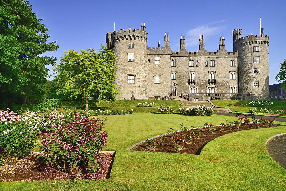 Ireland, County Kilkenny, Kilkenny, Kilkenny Castle with the Rose Garden in the foreground.