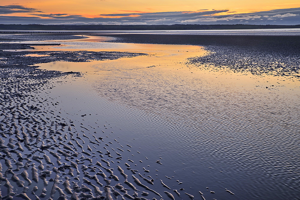 Wales, Llanfairfechan, Beach patterns at sunset.