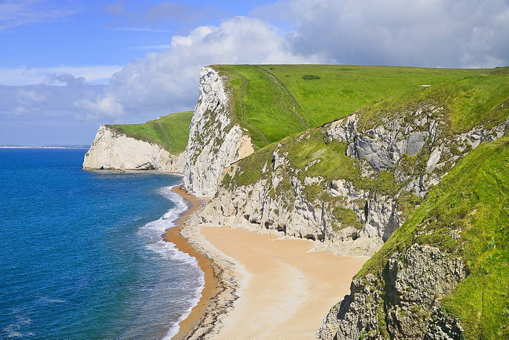 England, Dorset, Limestone cliffs adjacent to Durdle Door.