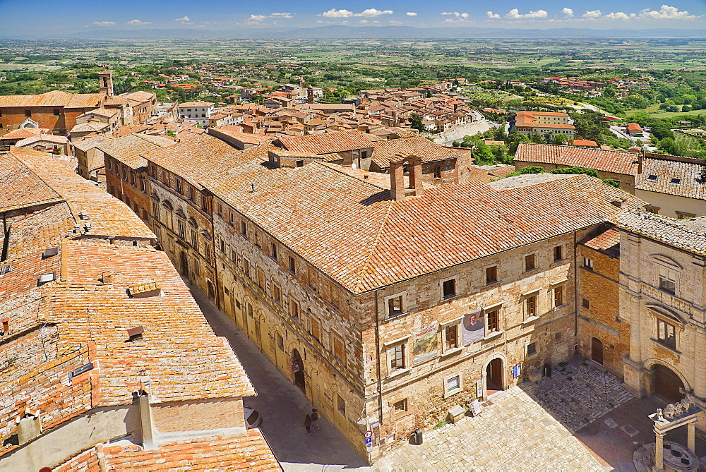 Italy, Tuscany, Montepulciano, View over the rooftops of the town towards distant hills from the tower of Palazzo Comunale or Town Hall.