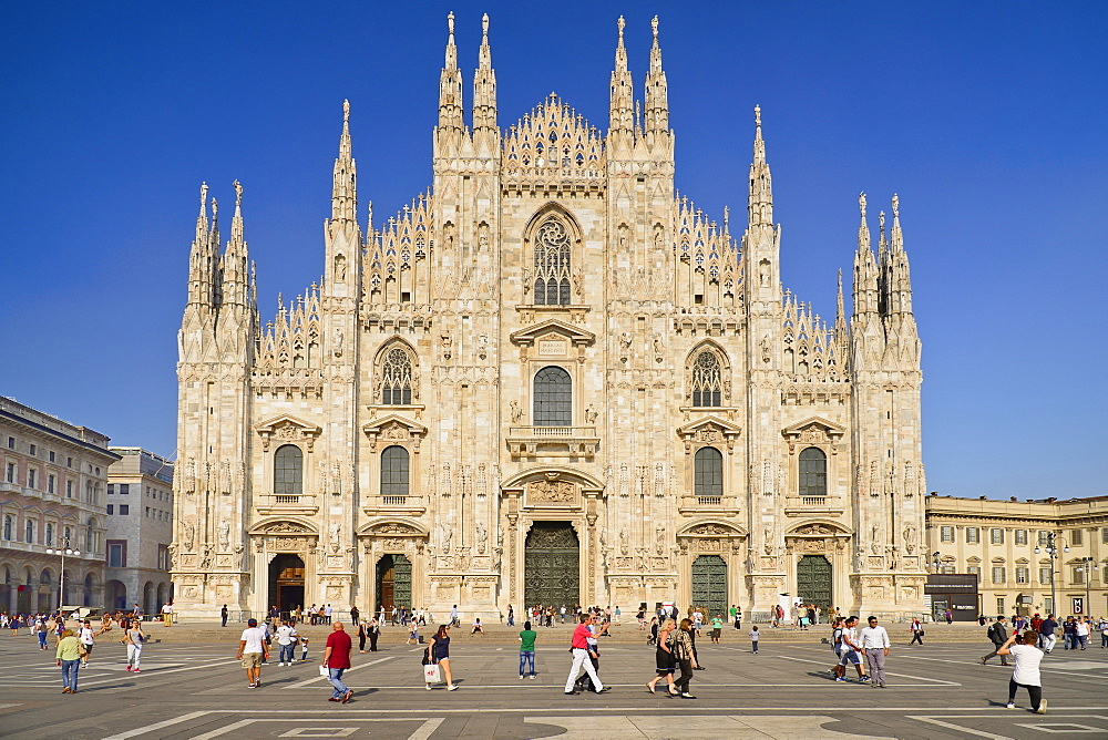 Italy, Lombardy, Milan. Milan Duomo or Cathedral, General view of the facade with tourists in the piazza out front. - 797-12999
