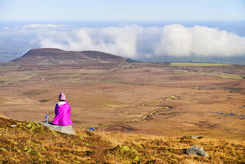 Ireland, County Fermanagh, Cuilcagh Mountain Park, Hiker enjoying the view from the summit of Cuilcagh Mountain. - 797-13012