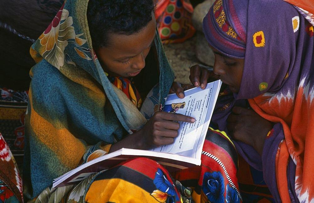 SOMALIA  People Baidoa girls reading text books produced by UNICEF African Eastern Africa Kids Learning Lessons Somalian Soomaliya Teaching