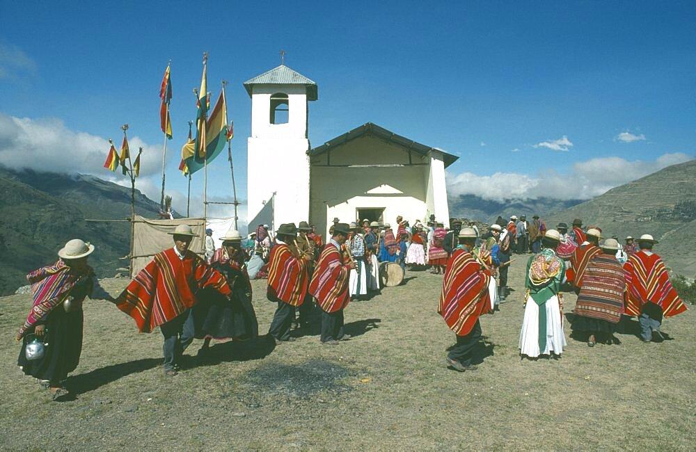 BOLIVIA La Paz Amarete Nino Corrine.  Fiesta de la Cruz.  Countrywide festival held on May 3rd.  Musicians and dancers outside hilltop church.