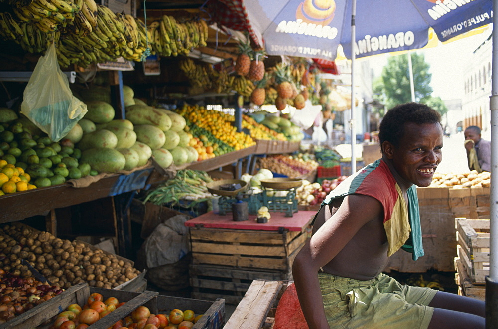 DJIBOUTI  Market Man at his stall in the fruit market