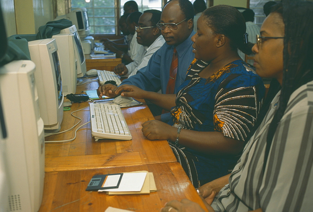 TANZANIA  Dar es Salaam Adult students learning computer skills.