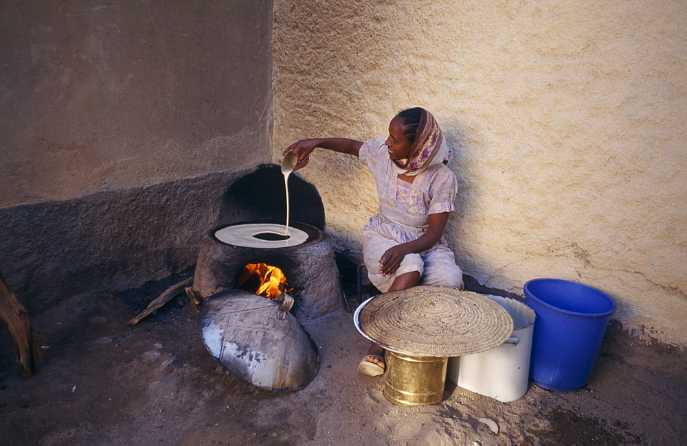 ERITREA  Keren Woman cooking injera  a type of sour  flat bread that accompanies most meals.