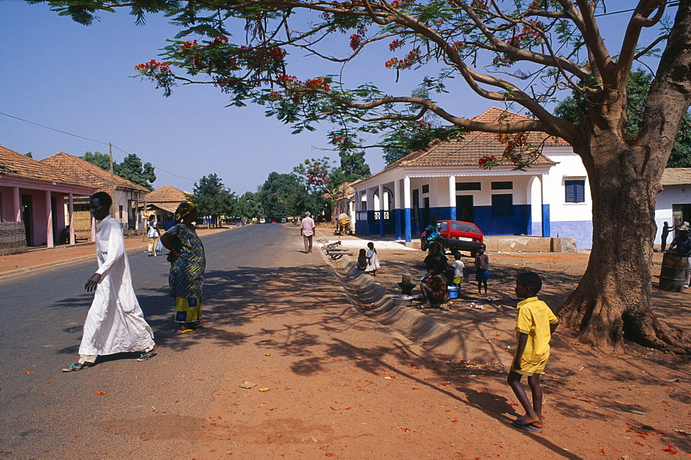 GUINEA BISSAU  San Domingos Street scene with people and roadside vendor in town in the Casheu region.