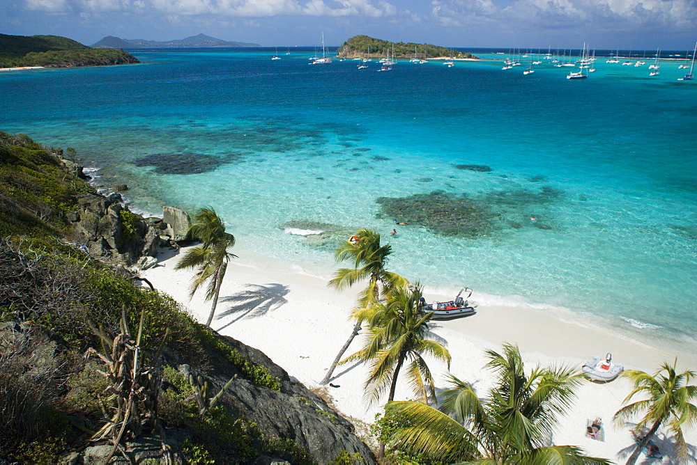 WEST INDIES St Vincent & The Grenadines Tobago Cays Looking over the Cays and moored yachts towards Canouan on the horizon  from Jamesby Island