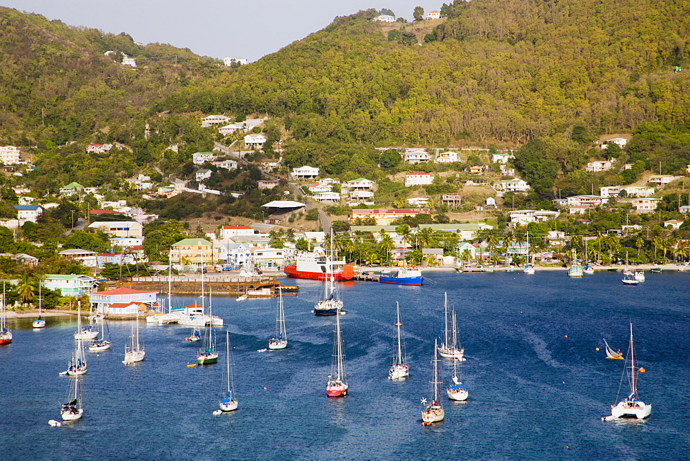 WEST INDIES St Vincent & The Grenadines Bequia Port Elizabeth with yachts moored in Admiralty Bay with the ferry port and hillside housing beyond