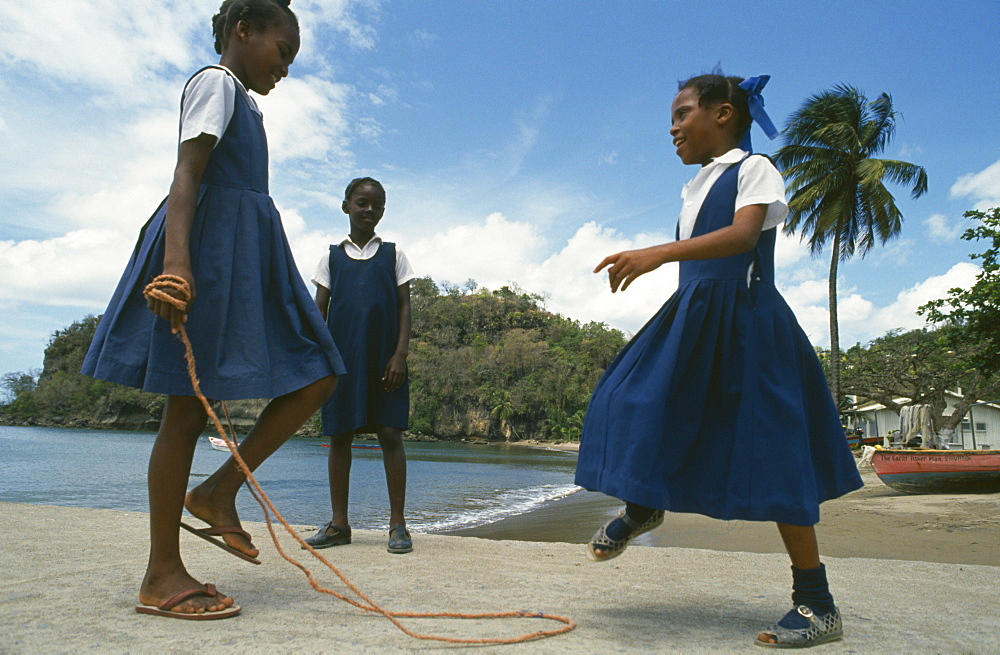 WEST INDIES St Lucia Anse La Raye Schoolgirls with skipping rope