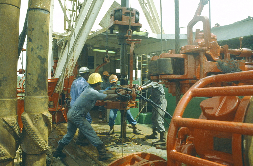 NIGERIA  Rivers State Workers using drill on oil rig.