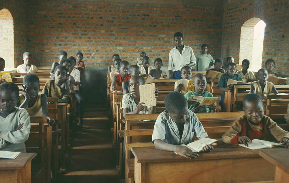 CONGO  Education Azande children sitting at wooden desks in school classroom. Zande Zaire