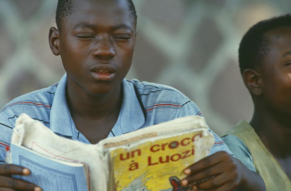 CONGO  Education Boy reading from French book.  Zaire