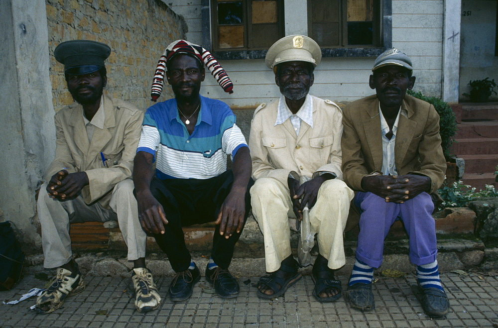 ANGOLA  Malange Four Malange chiefs seated and wearing different hats.