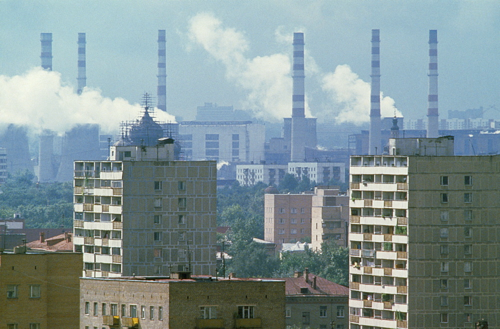 RUSSIA  Moscow Smoke billowing from power station chimneys behind residential housing. air pollution  smog   - 797-2780