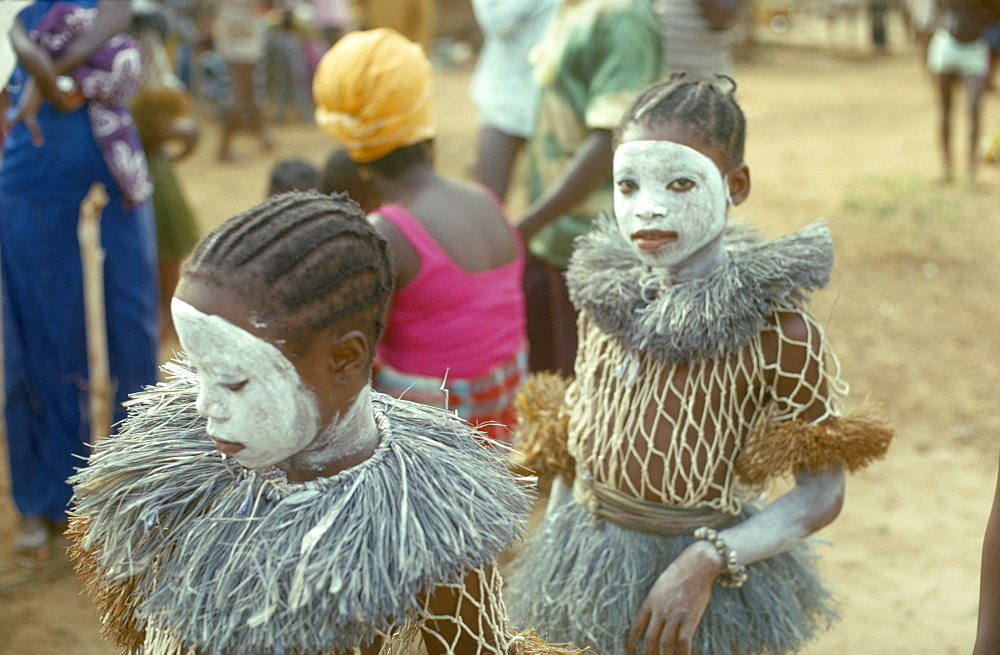 SIERRA LEONE  People Young girls attending initiation ceremony with white painted faces.