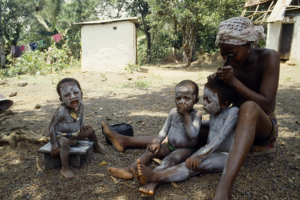 SIERRA LEONE  Mende Children are smeared with clay to protect them from both seen and unseen dangers.