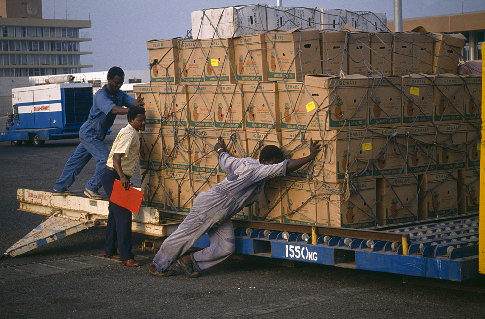 GHANA  Accra Loading crates of pineapples for export at Accra airport.  West Africa